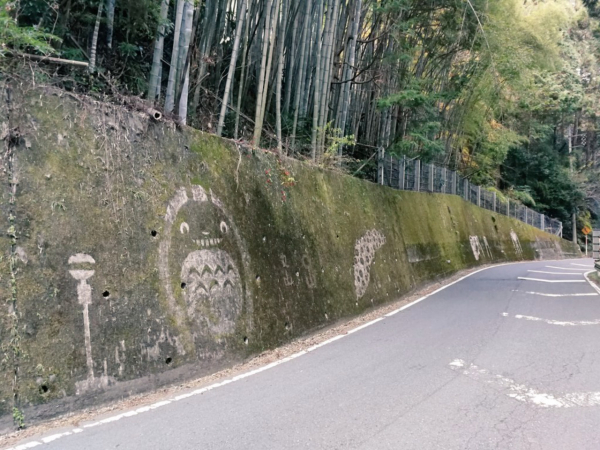 The Ghibli characters appear mysteriously on the moss wall in Japan