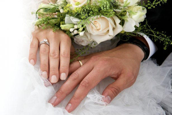 3 close up of newlywed couple holding rose bouquet